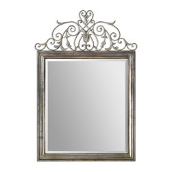 Uttermost - Kissara Metal Mirror - This regal Mediterranean style metal mirror wears its curly flourishes like a crown. With its heart shaped top, this tarnished silver mirror works a wonder as a dressing room mirror. Or pair it with its matching metal console table for your truly Tuscan flavored foyer.