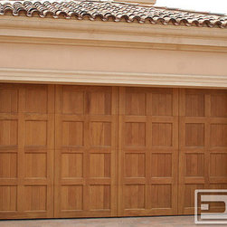 Dynamic Garage Door - California Dream 21 | Mediterranean Style Garage Doors in Bleached Mahogany Wood - Bleached African Mahogany Custom Garage Doors give the impression and look of a much warmer coloration but the durable density that is unique to Mahogany. Solid like a rock yet softer in color than what you would expect from a darker wood such as mahogany, this custom garage door brings the best of various wood species into one. Paired with a Marantec garage door opener, this door heavy as it is hardly makes a sound when operated at the push of a button.
