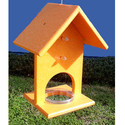 Songbird Essentials - Fruit and Jelly Oriole Feeder - Fruit and Jelly Oriole Feeder. Bright orange color attracts orioles. Feeder is made from recycled material which aides in keeping Plastic out of landfills. Holds more jelly than most fruit/jelly feeders and holds four orange halves. Made in the USA. 6 x 8