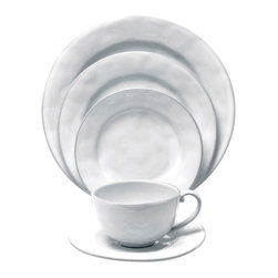 Quotidien 5 Piece Setting - White Truffle - Bring the entire Quotidien collections elegant simplicity to your table with the 5 piece white truffle place setting. Fit for the most exquisite dinner parties or suitable for everyday use, this classic set is one that never goes out of style. This beautiful place setting is complete with charger, dinner plate, dessert plate, coffee mug and saucer.