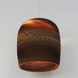 Bell Scrap Light - Here's an ingenious use for cardboard. In this bell-shaped pendant, the light not only escapes from the bottom, but is diffused through the grooves of pieced-together cardboard that make up the shade.