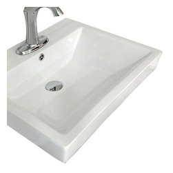 Bellaterra Home - Bellaterra Home 24W x 18.5D in. Ceramic Integral Sink Vanity Top Multicolor - 20 - Shop for Bathroom Counter Tops from Hayneedle.com! The Bellaterra Home 24W x 18.5D in. Ceramic Integral Sink Vanity Top is the perfect choice for a quick and easy remodel. This pristine white ceramic countertop with integrated sink features a geometric design that shows off elegant angles all the way around. The bowl itself is equally rectangular and dips down a comfortable 6-inches to provide you with plenty of comfortable space to wash up! A pre-drilled hole makes installation of a single slot faucet easy and the bowl also comes with a built-in overflow for less mess and added convenience. Faucet backsplash and drain are all sold separately.About BellaterraBy combining novel manufacturing processes with traditional craftsmanship and rigorous inspections Bellaterra retains an unblemished reputation for fine quality and customer service. For over 15 years the owners of Bellaterra have made certain that production is meticulously managed from choosing materials to the impeccable construction. All-wood finishes prevent humidity and water damage ensuring all Bellaterra products remain un-warped unstained and gorgeous for a lifetime.