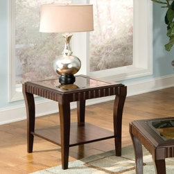 Standard Furniture Malibu Rectangular Dark Chocolate Wood and Glass Top End Tabl - Underneath the beveled glass top and the scalloped apron that creates a sense of constant motion, the Standard Furniture Malibu Rectangular Dark Chocolate Wood and Glass Top End Table is just like any other table, except better. The solid wood body sports a traditional, deeply-toned finish that highlights the wood-grain exterior while adding a bit of weight to the elegantly curved legs. A lower shelf adds stability and function, and if this style appeals to you, you should also consider the Malibu Rectangular Dark Chocolate Wood and Glass Top Coffee Table.About Standard FurnitureFounded in 1946 as a family owned, American-based company, Standard Furniture operates their own manufacturing and distribution facilities in Bay Minette and Frisco City, Alabama with more than 80% of their entire workforce based out of the United States. Their 1.4 million square feet of manufacturing space, 1.5 million square feet of warehouse space, and more than 40 trucks enable them to keep up with customer demand. Their main focus is to assist their customers in growing their retail businesses by supplying products that will sell due to quality, design, and value. As one of the leading case goods manufacturers in the market, Standard Furniture's continual growth and presence in the market place has remained steady over the last 60 years.