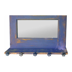 Rustic Blue Entry Mirror - This junk to jewel creation literally holds all your bags, coats, keys and hats. We took a discarded door, painted it in shades of blue, added vintage spigot handles for hooks and a mirror and voila! Shabadaba Chic organizer for any room in your house.
