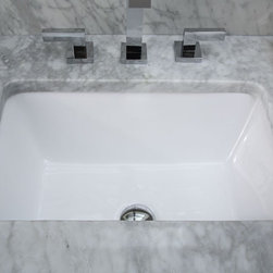 Xylem - 20 in. Rectangular Vitreous China Undermount - Manufacturer SKU: CUM198RWT. Vanity top, faucet, and drain not include. Custom vanity top cutout required. Under-Counter application. Vitreous China. cUPC Certified. 14.375 in. L x 19.875 in. W x 8 in. H (20 lbs.). View Specification SheetTimeless elegance meets everyday functionality with this undermount vitreous china sink.