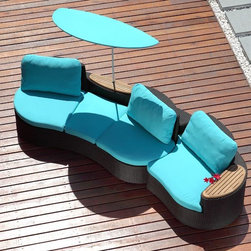 Wow Outdoor Sectional Sofa - The Wow outdoor sectional sofa has a curved front and back and arm sections with teak arm rests that nest around the center sofa section.