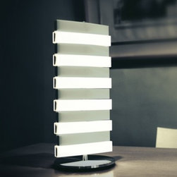 "QisDesign - QisDesign Piano Table Lamp - The  Piano Table Lamp by QisDesign has been designed by  QisDesign. Play  with Light. Inspired by the piano, the Piano Light, an LED lighting  fixture, allows users to play the light as if they were playing the  piano. Utilizing LED's low-temperature characteristic, which makes it  possible to touch the product's surface without being burned, the Piano  Light allows consumers to interact with the light The illumination is  made possible by a special light guide technique, another living example  of how QisDesign brings technology into home decor products. Not only  is it fun to play, it also provides enough illumination for reading. Its  piano-like sleek feel, coupled with the fun-to-play interface, brings  consumers an amazing experience.  Product description: The Piano Table Lamp by QisDesign has been designed by  QisDesign. Play with Light. Inspired by the piano, the Piano Light, an LED lighting fixture, allows users to play the light as if they were playing the piano. Utilizing LED's low-temperature characteristic, which makes it possible to touch the product's surface without being burned, the Piano Light allows consumers to interact with the light The illumination is made possible by a special light guide technique, another living example of how QisDesign brings technology into home decor products. Not only is it fun to play, it also provides enough illumination for reading. Its piano-like sleek feel, coupled with the fun-to-play interface, brings consumers an amazing experience. Slide your fingers across the keys and enter an experience of illuminating imagination. A melody of light will entrance you as it flows out from the Piano Light! The design is inspired by the piano keyboard, which allows users to play with light, as if they are playing with the music. Not only does the function take cue from the piano, the form also sports an elegant and classic look. The lighting panel is composed of independent units, each of which can work solo or in harmony. A simple and gentle tilt of the Piano Light, just like playing the piano, activates the illumination and fills the space with warm and tender light.  Details:                                     Manufacturer:                                      QisDesign                                                     Designer:                                     QisDesign                                                     Made in:                                     China                                                                  Dimensions:                                      Diameter Base: 7.87"" (20 cm) X Height Shade: 18.11""(46 cm)                                                                    Light bulb:                                      168 X White LEDs max 15W                                                                  Material:                                      Polycarbonate, Stainless Steel"