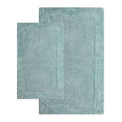 2 Piece Napoli Bath Rug Set - Step out of the shower and onto a tufted cloud of cotton. The contemporary 2 Piece Napoli Bath Rug Set has a non-slip backing to ensure a safe step and is available in a variety of pleasing colors to complement your decor. Set includes two matching rugs. Set Dimensions: Large rug: 24 x 40 inches Small rug: 21 x 34 inches About Chesapeake Merchandising, Inc. Started in Maryland in 1995, Chesapeake Merchandising, Inc. remains dedicated to producing quality textiles from the finest raw materials. Purveyors of fine rugs, linens, pillows and bedding, they strive to stay abreast on the latest trends in the industry in order to provide their customers with the most up-to-date styles for their homes. Chesapeake employs dedicated workers with a passion for quality. Their facilities are located in both India and the United States; their permanent showroom is located in New York, New York.