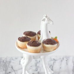 Giraffe Cake Stand - I might have to start baking more cupcakes so that I have an excuse to buy this stand. It's such a fun piece to add to your serveware collection.