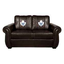 Dreamseat Inc. - Toronto Maple Leafs NHL Chesapeake BLACK Leather Loveseat - Check out this awesome Loveseat. It's the ultimate in traditional styled home leather furniture, and it's one of the coolest things we've ever seen. This is unbelievably comfortable - once you're in it, you won't want to get up. Features a zip-in-zip-out logo panel embroidered with 70,000 stitches. Converts from a solid color to custom-logo furniture in seconds - perfect for a shared or multi-purpose room. Root for several teams? Simply swap the panels out when the seasons change. This is a true statement piece that is perfect for your Man Cave, Game Room, basement or garage.