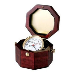 """Howard Miller - Howard Miller - Chronometer Table Top Clock - Combine a beautiful octagonal cherry hardwood chest with a wonderful solid brass captain�۪s alarm clock and you will get this wonderful offering. The octagonal chest includes a solid brass catch that allows the box to close safely to protect the treasure inside. The brass captain�۪s clock features a white Arabic face, black hour and minute hands, and a red hand to keep track of time down to the second. The exquisite solid brass Captain's Chest Alarm Clock rests upon gimbals inside a Cherry finished octagon hardwood chest with a solid brass catch! The distinctive and elegant El Capitan's Chest Alarm Clock glows with richly polished brass that complements the beautiful octagonal Cherry hardwood chest. * Open this unique, Cherry finished octagon hardwood chest to display a solid brass captain's alarm clock gimbaled to swivel to the angle of your choice.. White, Arabic numeral face features a convex glass crystal, and black hour and minute hands with a red second hand.. A solid brass catch keeps the box closed for safekeeping.. Quartz, alarm movement includes battery.H 3-3/4"""" (10 cm) W 7"""" (18 cm) D 5-1/2"""" (14 cm)"""