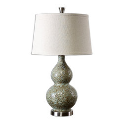 Uttermost - Hatton Ceramic Lamp - This ceramic table lamp has a dimpled textural finish and all the right curves to add interest and visual appeal to any room in your home. The pale-green-ivory glaze base is highlighted by the dark brown undertones and it perches on a brushed aluminum foot with matching finial.