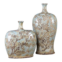 Citrita Ceramic Vessels - Set of 2 - The gentle blue of a spring sky serves as the backdrop for the Citrita Ceramic Vessels. Each vase boasts a floral imprint in delicate tones of aged umber set atop a distressed and crackled blue ceramic with antique khaki undertones. Used singly or as a pair, the vases impart a subtle yet dramatic beauty to a sideboard, fireplace, or glass-fronted cupboard. Available as a set of two.