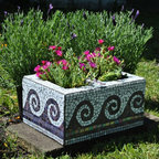 "Garden Mosaics - Upcycled mosaic cinder block garden planter-purple and white wave motif. This cinder block mosaic makes a great planter for herbs, succulents or lovely flowers. Approximate dimensions: 16"" long, 12"" wide, 8"" deep. There are 2 openings for plants that are each 8""x""5.5"" and 8"" deep. I used a combination of purple vitreous glass tile and white stained glass. Each piece was hand cut and shaped to fit perfectly."