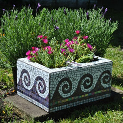 """Garden Mosaics - Upcycled mosaic cinder block garden planter-purple and white wave motif. This cinder block mosaic makes a great planter for herbs, succulents or lovely flowers. Approximate dimensions: 16"""" long, 12"""" wide, 8"""" deep. There are 2 openings for plants that are each 8""""x""""5.5"""" and 8"""" deep. I used a combination of purple vitreous glass tile and white stained glass. Each piece was hand cut and shaped to fit perfectly."""