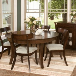 Oasis Amish 5 Piece Dining Table Set - Just what you need to enjoy countless meals with family and friends the Oasis Amish 5 pc. Dining Table Set makes its presence felt in any setting with its excellent Amish craftsmanship and simple classic design. Built to stand the test of time this set which includes an extendable dining table and four dining chairs will be at home in any upscale dining space.Crafted from responsibly harvested maple hardwood this sturdy dining set sports a beautiful multi-step graphite finish that complements most settings. You won't have to worry about accommodating last-minute guests either because it comes with two 12-inch leaves that let you extend the length from 54 to 78 inches in a snap. The armless chairs will envelop you in comfort thanks to the generous upholstered seats elegant backs and stylish saber legs. The perfect blend of timeless design and traditional Amish woodworking this dining set is sure to be cherished by your family for years to come.Additional Features:Dining table dimensions: 54 - 78L x 54W x 30H inchesDining chair dimensions (each chair): 23.5W x 17D x 36H inchesTraditional design with reverse bevel table edgeSeats 4 peopleMade in AmericaCare and Maintenance:Because most hardwoods are open grained solid wood furniture can be affected by changes in humidity and temperature even after protective finishes have been applied. Care in controlling the furniture's environment will help minimize the minor cracking and warping that is a natural part of the wood's character.Indoor humidity should be kept in the 35 to 40 percent range to minimize these effects. If the humidity moves out of the ideal range solid wood tabletops can expand or contract causing a gap in the center or at the ends where the two halves meet. This is perfectly normal as moisture is absorbed through end grains of wood causing more movement on the ends of the table than in the center. Through change of seasons these changes will occur according to humidity levels. Additionally direct sunlight and fluorescent fixtures that contain ultra-violet rays can cause chemical changes in the wood and finish and should be avoided. Furniture should also be kept away from direct sources of heating and cooling and out of attic or basement storing environments. With proper care solid wood furniture will provide a lifetime of enjoyment and can be passed on to future generations.About Fusion Designs:Backed by decades of experience in the furniture industry Fusion Designs offers some of the best hardwood dining occasional and hospitality furniture in the USA. Committed to maintaining the high standards of quality they are known for Fusion Designs prides itself on a work ethic instilled by generations of craftsmen. Having started off as a simple Amish woodworking shop Fusion Designs has today become a place where the foundation of the American heritage is honored while the pursuit of innovative design ensures scaling even greater heights in customer satisfaction in the future.