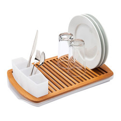 Umbra Slat Bamboo Dish Rack - Ah, the drying rack has been a source of anxiety for many years for me. They are so often poorly designed, and I hate having them on my countertop. But I think I could wrap my head around a cool rack like this.