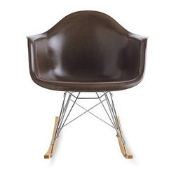 """Herman Miller - Eames® Molded Fiberglass Rocker (RFAR) - Charles and Ray Eames believed """"design is a method of action,"""" and they continually updated their work as new materials became available. """"The chair that Charles and Ray were designing,"""" explains grandson Eames Demetrios, """"is the chair that's made tomorrow."""" The duo originally designed their molded chair in metal and entered it as a prototype in MoMA's 1948 International Competition for Low-Cost Furniture Design, then refashioned it in light yet strong fiberglass just two years later. In the 1980s, after determining fiberglass production was detrimental to the environment, Herman Miller ceased production to explore more sustainable options, eventually choosing recyclable polypropylene. The company never quite forgot about fiberglass, however, and it recently began researching greener production methods. The Eames Molded Fiberglass Chair (1950) is the end result, constructed using a cleaner process but true to the original with its beloved variegated surface. This reintroduced version comes in a range of reformulated semi-gloss color pigments that faithfully reproduce the vintage ones. Its deep seat pocket and waterfall edge keep you comfortable by reducing pressure on the backs of your thighs. This is an authentic Eames product by Herman Miller. Made in U.S.A. RFAR stands for rocker-height fiberglass armchair with rocking base. Made of 99% recyclable materials and covered by Herman Miller's take-back program for environmentally sound recycling (should you ever wish to part with this chair)."""