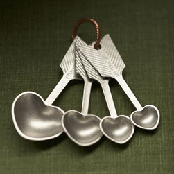 Are Naturals - Each of these heart measuring spoons features a heart-shaped shell, detailed arrow handles, and is hung from a twisted copper ring. Standard increments are conveniently engraved atop each spoon for precise measurements. Put a spoonful of love in every recipe!