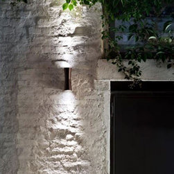 Flos - Flos   Clessidra Outdoor Wall Light - Design by Antonio Citterio, 2011By Flos.The Clessidra Outdoor Wall light is composed of an aluminum body and a PMMA diffuser for diffused direct and indirect lighting. Features a wide range (100-240V) power pack integrated in the body. Non-dimmable. Available in painted anthracite finish with white backplate or painted dark brown finish with brown backplate and a choice of a 20° or 40° beam spread.IP65 Rated. ADA Compliant. UL Listed.