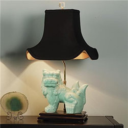 Chic Turquoise Foo Dog Table Lamp - These chic turquoise blue lamps come in right-facing or left-facing with black silk shades — these are great colors.