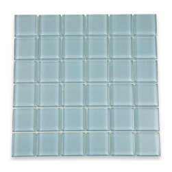 "Loft Blue Gray Polished Glass Tiles - Loft Blue Gray Polished 2x2 Glass Tile Add a subtle and simple design with this shade of blue gray tiles. These glass tile give a luminescent quality to any bathroom, kitchen, or pool installation. The mesh backing not only simplifies installation, it also allows the tiles to be separated which adds to their design flexibility. Chip Size: 2""x2"" Color: Blue Gray Material: Glass Finish: Polished Sold by the Sheet - each sheet measures 12"" x 12"" (1 sq. ft.) Thickness: 8mm Please note each lot will vary from the next."