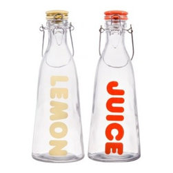 Home Essentials - Vintage Glass Lemon and Juice Bottles - These adorably chic bottles are handy for keeping water, orange juice, lemonade or any beverage of your choice flowing! They are also useful for carrying water in the car or office if you like to avoid plastic. So finally throw out those plastic bottles that have been on your kitchen counter or desk for way too long!  Replace it with these old fashioned wire and bail bottles; they are both beautiful to look at and will make you feel so chic when pouring your beverages! The glass bottles also make great corporate gifts and are perfect for the environmentalist or person who has everything.    * Set of 2  * Capacity: 32 oz  * Height: 10.5""