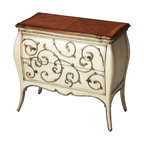 Butler Specialty - Butler Eden Carved Wood Bombe Chest - This stunning hand carved bombe chest will be the focal point of any space. Expertly crafted from gemelina wood solids and wood products, its honey finished matched maple veneer top is beautifully flaunted by filigree hand carving on the drawer fronts. Includes two spacious drawers with antique brass finished hardware.