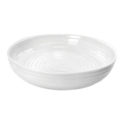 Portmeirion - Sophie Conran White Round Roasting Dish - 422261 - Shop for Baking & Roasting Dishes from Hayneedle.com! Mom's pot roast requires a sturdy pan and the Sophie Conran White Round Roasting Dish is it. Crafted of durable porcelain this versatile pan is designed to go from oven to table. It's dishwasher-safe and you can also pop it in the freezer or microwave. Use just one pan from start to finish now that's efficient. Mom would be proud.About PortmeirionStrikingly beautiful eminently practical refreshingly affordable. These are the enduring values bequeathed to Portmeirion by its legendary co-founder and designer Susan Williams-Ellis. Her father architect Sir Clough Williams-Ellis was the designer of Portmeirion the North Wales village whose fanciful architecture has drawn tourists and artists from around the world (including the creators of the classic 1960s TV show The Prisoner). Inspired by her fine arts training and creation of ceramic gifts for the village's gift shop Susan Williams-Ellis (along with her husband Euan Cooper-Willis) founded Portmeirion Pottery in 1960. After 50+ years of innovation the Portmeirion Group is not only an icon of British design but also a testament to the extraordinarily creative life of Susan Williams-Ellis.The style of Portmeirion dinnerware and serveware is marked by a passion for both pottery manufacturing and trend-setting design. Beautiful tactile nature-inspired patterns are a defining quality of Portmeirion housewares from its world-renowned botanical designs modeled on antiquarian books to the breezy natural colors of its porcelain and earthenware. Today the Portmeirion Group's design legacy continues to evolve through iconic brands such as Spode the Pomona Classics collection and the award-winning collaboration of Sophie Conran for Portmeirion. Sophie Conran for Portmeirion:Successful collaborations have provided design inspiration throughout Sophie Conran's life. Her father designer Sir Terence Conran and mother food writer Caroline Conran have been the pillars of her eclectic mix of cooking writing and interior design. In pairing with the iconic British housewares brand Portmeirion Conran has created another successful collaboration: Sophie Conran for Portmeirion an award-winning collection of dinnerware serveware and drinkware for the practical multi-functional needs of contemporary kitchens.Launched in 2006 Sophie Conran for Portmeirion immediately received the Elle Deco Style Award for Best in Kitchens and two years later the House Beautiful Award for Best in Tableware. The soulful tactile beauty of these oven-to-tableware pieces is exemplified by rippled surfaces and edges that evoke a potter's hand. This down-to-earth style is complemented by charming pastels gentle earth tones and classic whites and pinks for a collection that will lighten and enliven contemporary kitchen decors. Though delicate to the eye and touch these plates and bowls are built for durable performance with microwave- and dishwasher-safe porcelain that's casual enough for breakfast and elegant enough for eye-catching dinners.