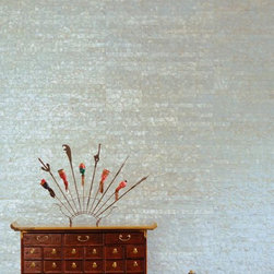 Mother of Pearl Wallcovering - Mother of Pearl™ Wall Tiles are composed of genuine hand-inlaid capiz shells. Install Mother of Pearl™ in a running bond for a virtually seamless installation. It's patent-pending finish is durable, cleanable, and flexible. When pasted, tiles have the capability to turn corners and wrap columns. Install as easily as other tiles. Available in natural or various translucent hues. Hand-crafted in Chicago. Winner Best New Surface at NeoCon. Color variation is inherent in the natural shell. Custom colors and tile sizes available (40 tile minimum).