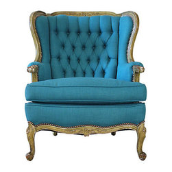 Peacock Blue Wing Chair - Soul and Love Designs.  Refurbished vintage wing back chair freshly upholstered in a striking peacock blue cotton blend fabric. Antique brass nailhead trim accents the carved wood trim. The original rustic patina was left intact on wood trim and finished with hard wax paste