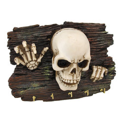 Zeckos - Skeleton Crawling Out of the Woodwork Key Hanger - This cool key hanger features a creepy skeleton crawling out of the woodwork. Made of cold cast resin, it measures 7 1/4 inches long, 5 inches tall, and 2 inches deep. It is hand painted and shows awesome detail, from the grain of the wood to the bones of the fingers. It mounts easily to the wall with just 1 screw or nail and has 5 brass hooks to hold your keys. It makes a great gift, and may encourage those who like to party hardy to think twice before they drive.