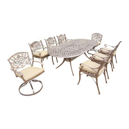 Oakland Living - 9-Pc Traditional Dining Set - Includes table and six dining chairs, two swivel cushioned rockers and metal hardware. Handcast. Umbrella hole table top. Fade, chip and crack resistant. Traditional lattice pattern and scroll work. Hardened powder coat. Rust free. Warranty: One year limited. Made from cast aluminum. Antique bronze finish. Minimal assembly required. Table: 84 in. L x 42 in. W x 29 in. H (99 lbs.). Chair: 21.5 in. W x 23 in. D x 34 in. H (27 lbs.)The Oakland Mississippi Collection combines southern style and modern designs giving you a rich addition to any outdoor setting. This dining set is the prefect piece for any outdoor dinner setting. Just the right size for any backyard or patio.