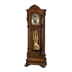 """Howard Miller - Howard Miller - Hamlin Floor Clock - This Chris Bergelin designed time piece features a distressed frame finish, shell and leaf design on upper arch, and matching brass dial and pendulum. This clock is versatile, with automatic chime shut-off, adjustable base levelers, and locking doors that make it ideal for anyone interested in investing in a beautiful piece of furniture. The majestic Hamlin Grandfather Clock in Embassy Cherry displays an attractive distressed Rustic Cherry finish with lustrous brushed antique brass detailing and a decorative antique gold-finished center disk. The 93"""" tall clock features automatic nighttime chime shut-off and a locking cabinet. * An heirloom-style floor clock with a distressed finish, designed by Chris Bergelin. . A carved shell and leaf design draws the eye up to the arched pediment, which is embellished with decorative overlays on the canted corners. . The brushed antique brass dial is set off by cast corner and center ornaments, a silver chapter ring with applied brass Arabic numerals, and an astrological blue moon phase dial. . Mirroring the dial, the lyre pendulum is finished in brushed antique brass with a decorative antique gold-finished center disk. . The brushed antique finish and decorative bands of the weight shells also complement the dial. . The lower front door features beveled glass and decorative overlays with matching shell and leaf designs. . Canted, reeded columns frame the case, offering intricately carved column caps with a unique scroll design and Acanthus leaf details. . The multi-tiered, Bombay base offers canted corners and carved scroll feet with Acanthus leaf details. . Removable beveled glass panels on the upper sides allow easy access to the movement. . Cable-driven, triple chime Kieninger movement offers automatic nighttime chime shut-off option. . Finished in distressed Rustic Cherry on select hardwoods and veneers. . Adjustable levelers under each corner provide stability on uneven a"""