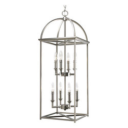 """Thomasville Lighting - Thomasville Lighting P3888-126 Burnished Silver Piedmont Piedmont 8 - Thomasville Lighting P3888-126 Eight Light Piedmont Foyer PendantCombining classic sensibilities with modern elements, the soaring arches and candle chaser accents add a timeless charm to this eight light foyer pendant. Featuring a simple vertical structure with open arching roof and center inspired by classic Shaker design with a modern Burnished Silver twist, this fixture makes the perfect addition to any foyer.Thomasville Lighting P3888-126 Features:Burnished Silver FinishSeveral Optional Shades AvailableThomasville Lighting P3888-126 Specifications:Number of Bulbs: 8Watts Per Bulb: 60Bulb Base: CandelabraBulb Type: IncandescentBulb Included: NoUL Listed: Dry LocationHeight: 34""""Maximum Overall Height: 109""""Width: 17.25""""Wire Length: 180""""The story of Thomasville began in Thomasville, North Carolina, in 1904. At the time, they offered just one product – a chair. The """"Thomasville Chair"""" it was called. The chair was so beautifully crafted and well made that people responded by asking them to create other pieces as well. For over 100 years Thomasville has set the standard for luxury design for the entire furniture industry. Now Thomasville is making available over a century of expertise in quality craftsmanship and exquisite styling in a stunning new line of elegant lighting. Thomasville Lighting will add beauty and value to your home with the timeless style and superior workmanship you have come to expect only from Thomasville."""