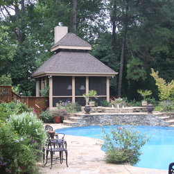 Pools - This property backs up to the Chattahoochee River therefore the pool has to be a Vinyl pool due to water table. This pool area has it all - enclosed gazebo with fireplace, open gazebo, Cedar Pergolas with metal seam rooks over the elevated stone decks off back of house, cook center and much more.