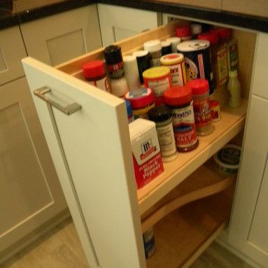 Midwestern Mod - Pull out spice/oil cabinet with swivel out side shelf