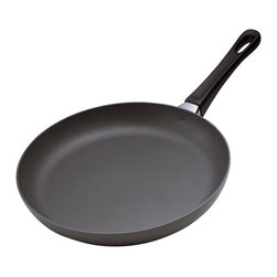 """Scanpan Classic 9 1/2 """" Covered Fry Pan - The Scanpan Classic 9 1/2 """" Fry Pan is a small skillet perfect for a few scrambled eggs  a side of vegetables  or an omelette.  This pan includes a lid.  Scanpan Classic cookware is designed for high-heat cooking such as frying  searing or sauteing  heats evenly  and the sloped sides make it easy to turn and flip food. Scanpan Classic cookware is manufactured with a patented ceramic-titanium nonstick technology that is completely PFOA free throughout the entire manufacturing process.  The ceramic titanium coating gives you incredible nonstick performance along with a nonstick skillet that isin't afraid of metal utensils! Made in Denmark. Full lifetime warranty. Dishwasher safe.Product Features                          Includes lid            Made from 100% recycled squeeze-cast aluminum            Patented ceramic titanium with PFOA-free non-stick surface allows the use of metal utensils            Oven safe up to 260 DegreesC/500 DegreesF            Patented locking system with no rivets for maximum durability and easy cleaning            Guaranteed not to warp            Lifetime Warranty            Eco friendly ceramic titanium surface will never peel even with the use of metal utensils            Suitable for all stove tops  except induction            Designed and manufactured in Denmark"""