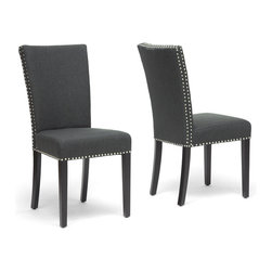 "Wholesale Interiors - Harrowgate Dark Gray Linen Modern Dining Chairs, Set of 2 - No frills, no fuss, but plenty of fashion! The simplistic Harrowgate Dining Chairs have the straight line-inspired design of popular modern style but comforting dark charcoal gray linen upholstery and traditional silver nail head trim along most outer edges. This set of two chairs is made with birch frames and foam cushioning (CA117 flame retardant). Completing your new dining room furniture set are black lacquer legs with non-marking feet. Made in China, the modern chairs are fully assembled and should be spot cleaned. Product dimension: 18.5""W x 23""D x 39""H. Seat dimension: 18.5""W x 16.75""D x 20.5""H."