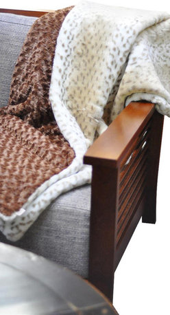 Belle & June - Snow Leopard & Mocha Throw - What if you could mix exotic and cozy into one rich-colored, ultra soft and snugly blanket? This coverlet combines the romantic far away feline faux fur of a snow leopard and the creamy goodness of a mocha latte into one wrap you will covet. The snow leopard and mocha throw looks and feels divine and is certainly the cat's meow!