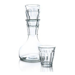 French Decanter - This carafe is the smaller brother of the original French Carafe (2005) but its design makes it absolutely perfect for decanting and serving wines. The wide base of the carafe gives the carafe, apart from good stability, the functionality of decanting your wine. By pouring the wine into our carafe wines can breathe well and any sediment or dregs will settle nicely at the bottom. The standard contents of a wine bottle (0.75 litre) perfectly fit our carafe.The French Decanter set is, like the French Carafe, inspired by the Picardie glasses, the famous French design icon from the last century. These two carafes together are the perfect table setting.