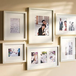 """Gallery in a Box, Esprsso stain Frames, Set of 10 - Our Gallery in a Box set comes with everything you need to easily create a beautiful wall of memories. Choose from a set of six or a set of 10 wood frames with archival mats to add a display in any space. For decorating ideas to transform your walls, {{link path='shop/accessories-decor/gallery-wall-ideas'}}click here{{/link}} to view our Wall Solutions Tool. Set of 6 contains frames listed below: Single-Photo Frame (1): holds one 4 x 6"""" photo 3-Photo Frame (1): holds three 4 x 6"""" photos Single-Photo Frame (2): holds one 5 x 7"""" photo 2-Photo Frame (1): holds two 5 x 7"""" photos Single-Photo Frame (1): holds one 8 x 10"""" photo Set of 10 contains frames listed below: Triple Wood Gallery Frame (2): holds three 4"""" x 6"""" photos Single Wood Gallery Frame (2):  holds one 4"""" x 6"""" photo Single Wood Gallery Frame (3):  holds one 5"""" x 7"""" photo Double Wood Gallery Frame (1): holds two 5"""" x 7"""" photos Single Wood Gallery Frame (2):  holds one 8"""" x 10"""" photo Crafted of alder wood with either a black, white or espresso painted finish. Bevel-cut archival quality mat is included: Black and White frames with a white mat. Espresso with an ivory mat. Includes 3 templates for creating a horizontal, vertical or stairway configuration. View and print our gallery frames style guide, {{link path='/pages/popups/Gallery_Frames.html'}}click here{{/link}}."""