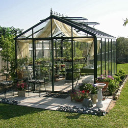 Exaco Trading Co - Janssens Royal Victorian 10.1 x 15-Foot Greenhouse - VI-34 - Shop for Greenhouses from Hayneedle.com! Additional FeaturesVertical glass pieces are only 1 pieceSingle glass design keeps greenhouse cleanerHas 3 roof windows and 1 Louvre windowLouvre window adds additional air flowHas a full length gutter with downspouts on each sideIncludes assembly instructions and a DVDDoor measures 28W x 72H inchesSidewall height measures 6.58 feetPeak height measures 9H feetMeasures 10.1W x 15L x 9H feetEnjoy gardening in your beautiful and spacious Royal Victorian 10.1 x 15-Foot Greenhouse. Strong and durable this greenhouse has a thick and strong aluminum framework with 4mm tempered glass that ensures your greenhouse has enough insulation. This glass is about 1mm thicker than most competitors. The glass panels are of a single glass design which makes your greenhouse stronger and helps to keep it cleaner. The glass panels are also secured with heavy duty rubber sealing to ensure durability. The greenhouse has three roof windows and one Louvre window which adds additional air flow. Two full length gutters with downspouts on each side allows you to collect natural water. Assembly instructions and a DVD are included. Assembly is a weekend project for one or two people.About JanssensKnown as the incredibly sensible greenhouse company Janssens has been associated with quality greenhouses and orangeries and continuously gains knowledge and experience with these products. If you're looking for a greenhouse they're confident they have what you want. Janssens bases their business on their ability to listen and adapt to individual customer requirements from the get go. Their experience knowledge and flexible approach together with a high level of openness and integrity have resulted in an enviable level of customer recommendation. As they continue to progress they retain their old fashioned virtues of customer service and satisfaction.