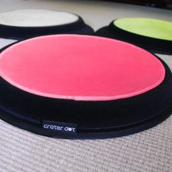 Sleepypod Crater Dot - This pet bed is cool looking and made with the pet in mind. The fabric is a durable polyester in bright, fun colors. For the smaller buddies, it has a warmer kit. It would be the perfect pet bed for a playroom or child's room with it's fun design.