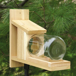 Songbird Essentials - Squirrel Jar Feeder - Squirrel Jar Feeder. This you've got to see! Treat your furry friends while protecting their peanuts from the elements and marauding jays. You'll enjoy the view of fur in a jar. Opening for squirrel to enter through is 4 inches wide.