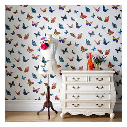 Graham & Brown - FlutterBy Wallpaper - Featuring beautiful butterflies in a kaleidoscope of colours, this striking design on a pearl white shimmering background with holographic glitter embellishments is flirty and fun. These fabulous butterflies bring sunshine indoors whatever the weather
