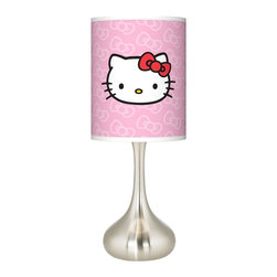 "Hello Kitty - Kids Hello Kitty Classic Giclee Kiss Table Lamp - Add a bold cheerful accent to your home décor with this Hello Kitty Classic kiss table lamp in sleek brushed steel finish. Officially licensed from Sanrio the contemporary design brings the iconic Hello Kitty to life on a custom-printed giclee shade. The high-quality opaque fabric blocks illumination coming through the shade focusing the light throw up and down. U.S. Patent # 7347593. Officially licensed design from Sanrio. Brushed steel finish table lamp. Hello Kitty Classic pattern giclee shade. Maximum 100 watt bulb (not included). 24 1/2"" high. Shade is 9 1/2"" wide and 11 3/4"" high. Base is 7 1/2"" wide. May only ship to the United States  its territories possessions and the Commonwealth of Puerto Rico. ©1976 2013 Sanrio Co. Ltd. Used Under License.  Officially licensed design from Sanrio.   Brushed steel finish table lamp.   Hello Kitty Classic pattern giclee shade.   Maximum 100 watt bulb (not included).   24 1/2"" high.   Shade is 9 1/2"" wide and 11 3/4"" high.   Base is 7 1/2"" wide.  May only ship to the United States  its territories possessions and the Commonwealth of Puerto Rico.   ©1976 2013 Sanrio Co. Ltd. Used Under License."