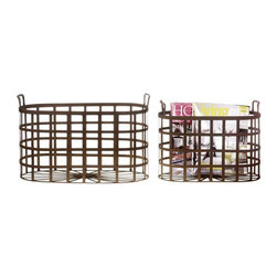Oval Metal Baskets (Set of Two) - Distinctively shaped with a sinuous design on the floor of the set, these rust colored metal catch alls can keep magazines and catalogues in check until you have time to leisurely peruse each one. Stand up handles make it easy to move the baskets to your chaise longue.