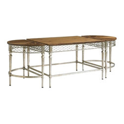 Stanley Furniture - Charleston Regency-Trinity Cocktail Table - A metallic apron of braided trellis finished in Champagne Silver Leaf encircles the top of the Trinity Cocktail Table in Clear Walnut. The Cocktail Table is comprised of two demilune-shaped end pieces and a rectangular center section that together form an astragal.
