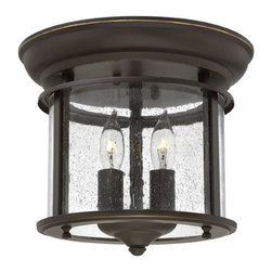Hinkley Lighting - Gentry 2-Light Flush Foyer - Gentry's traditional design is offered in three classic finishes, Olde Bronze, Pewter and Polished Brass. The clear bent glass panels, white candle sleeves and coordinating candle chasers add classic elegance to this timeless style.